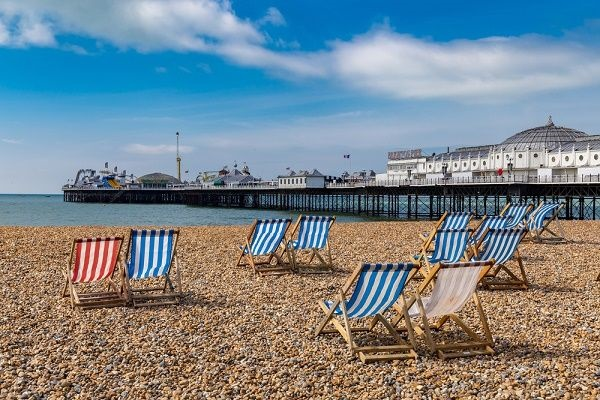 Image of the famous Brighton pebble beach and Brighton pier