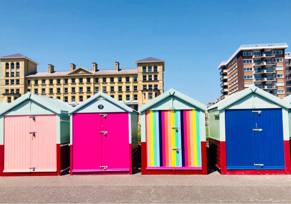 Brightly coloured beach huts for Brighton and Hove Pride