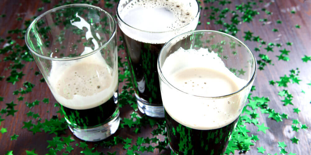 Pints of Guinness with green stars on table
