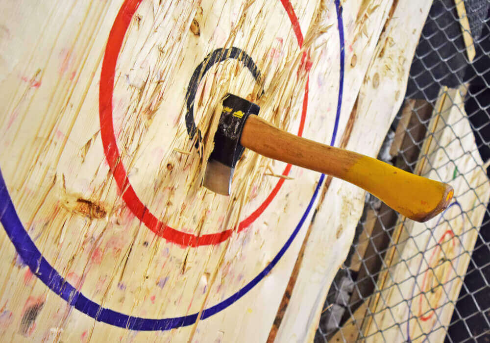 Throwing axe on target board
