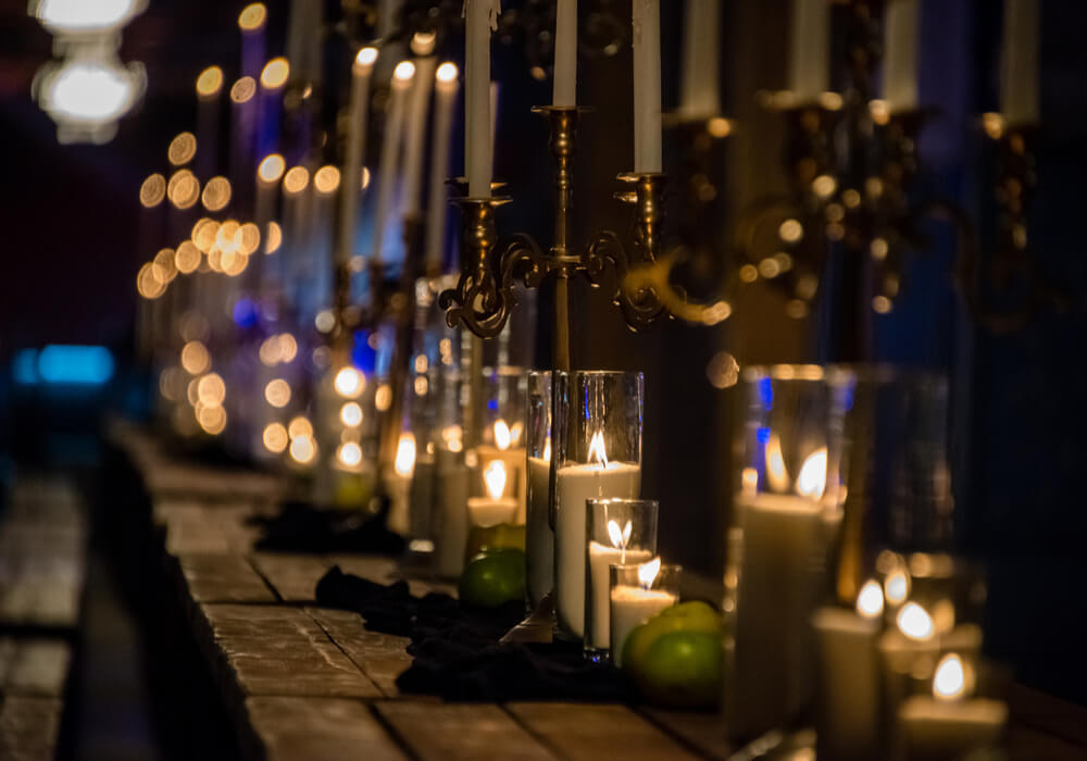 Long wooden banquet table with candles