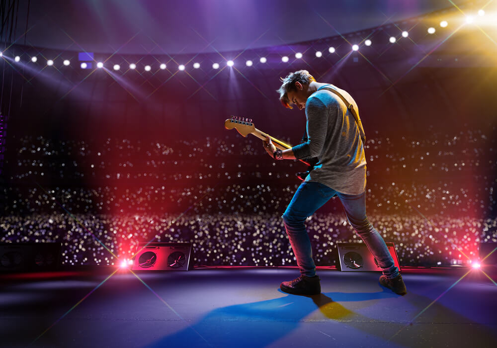 Rockstar performing with guitar