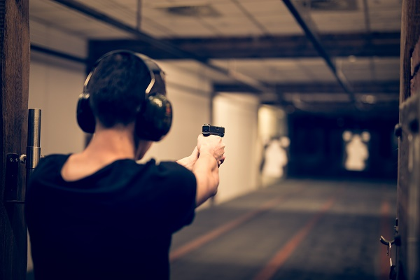 Man trying a shooting experience activity on stag do