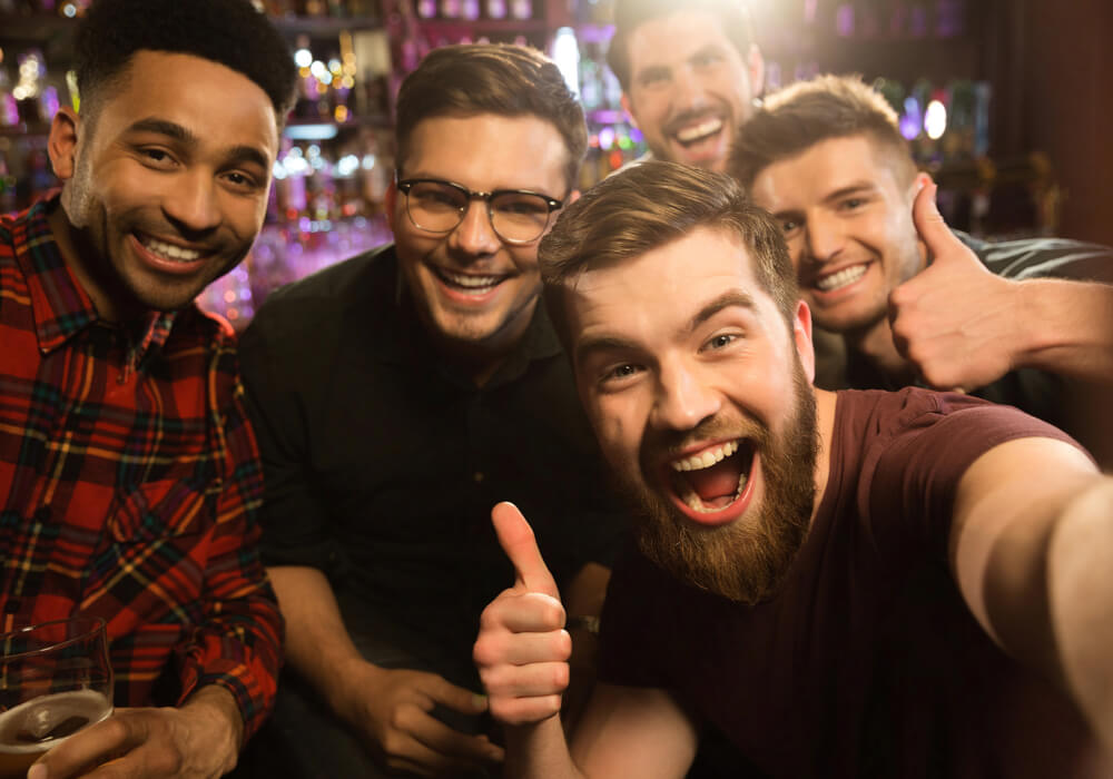 Group of men smiling and celebrating