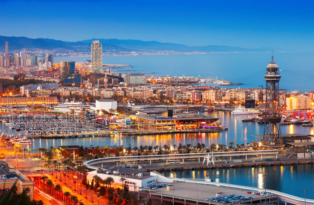 Barcelona city and port in the evening