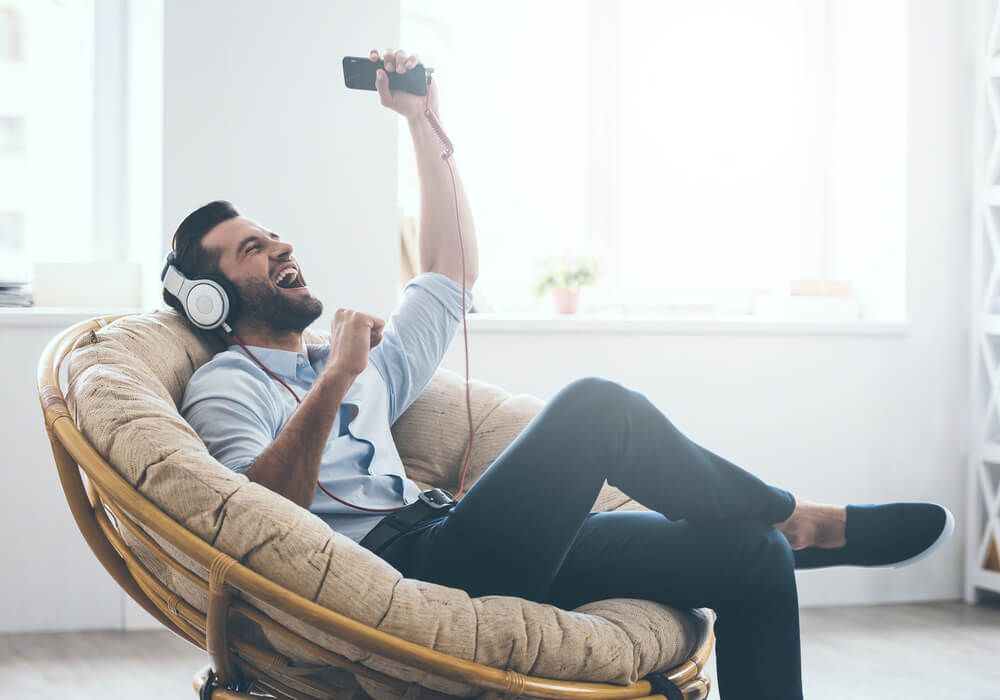 Man listening to music on virtual stag do